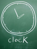 Clock drawn with chalk on blackboard — Stock Photo