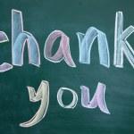Thank you title written with chalk on blackboard — Stock Photo