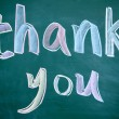 Thank you title written with chalk on blackboard — Stock Photo #9633936