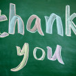 Thank you title written with chalk on blackboard — Stock Photo