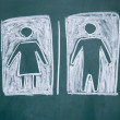 Women and men sign drawn with chalk on blackboard - Stockfoto