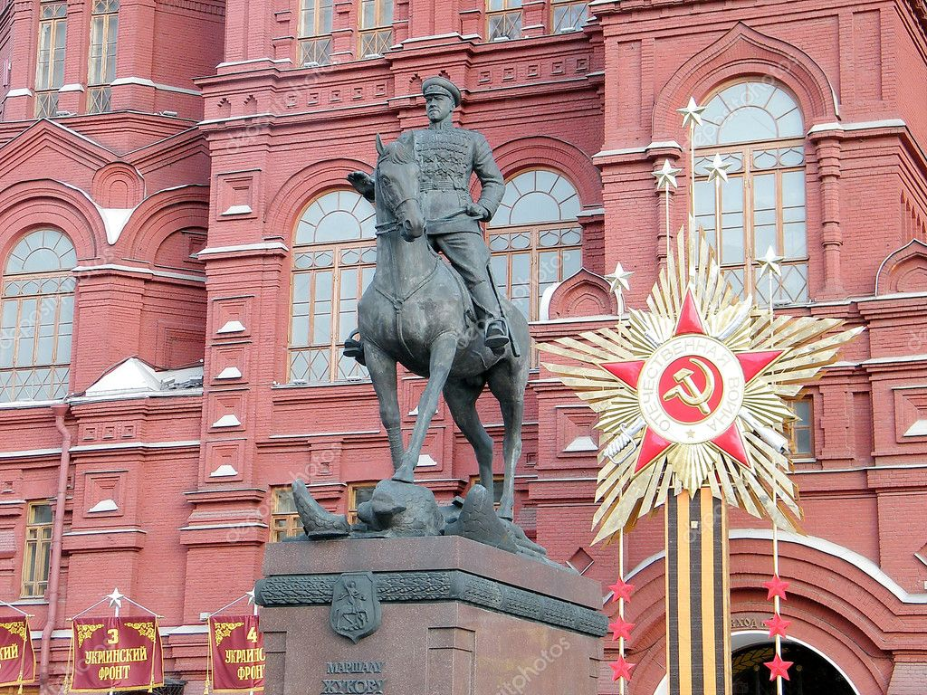 Monument to Marshal Zhukovon the background of the Historical Museum in  Moscow, Russia  Stock Photo #10274766