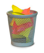 Colored crumpled paper in waste basket — Stock Photo