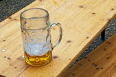 Beer mug in rain — Stock Photo