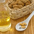 Peanut oil with peanuts - Stock Photo