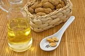 Peanut oil with peanuts — Stock Photo