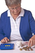 Pensioner counting her retirement pay — Stock Photo
