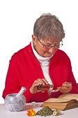 Pensioner taking herbal drops — Stock Photo