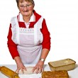 Stock Photo: Pensioner baking whole grain bread