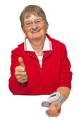 Pensioner is measuring her blood pressure — Stock Photo