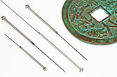 Acupuncture needles with chinese coin — Stock Photo