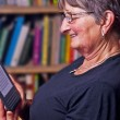 Pensioner with e-book reader — Stock Photo #8611405