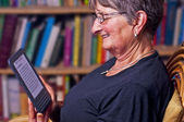 Pensioner with e-book reader — Stock Photo