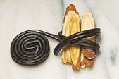 Licorice raw and candy — Stock Photo