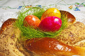 Easter bread with painted eggs — Stock Photo