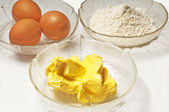 Baking ingredients,egg, margarine and flour — Stock Photo