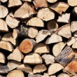 Stock Photo: Firewood stacked in pile