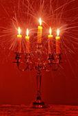 Burning candles emitting rays — Stock Photo