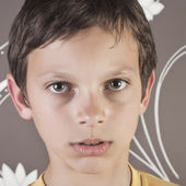 Young boy looking at camera — Stock Photo