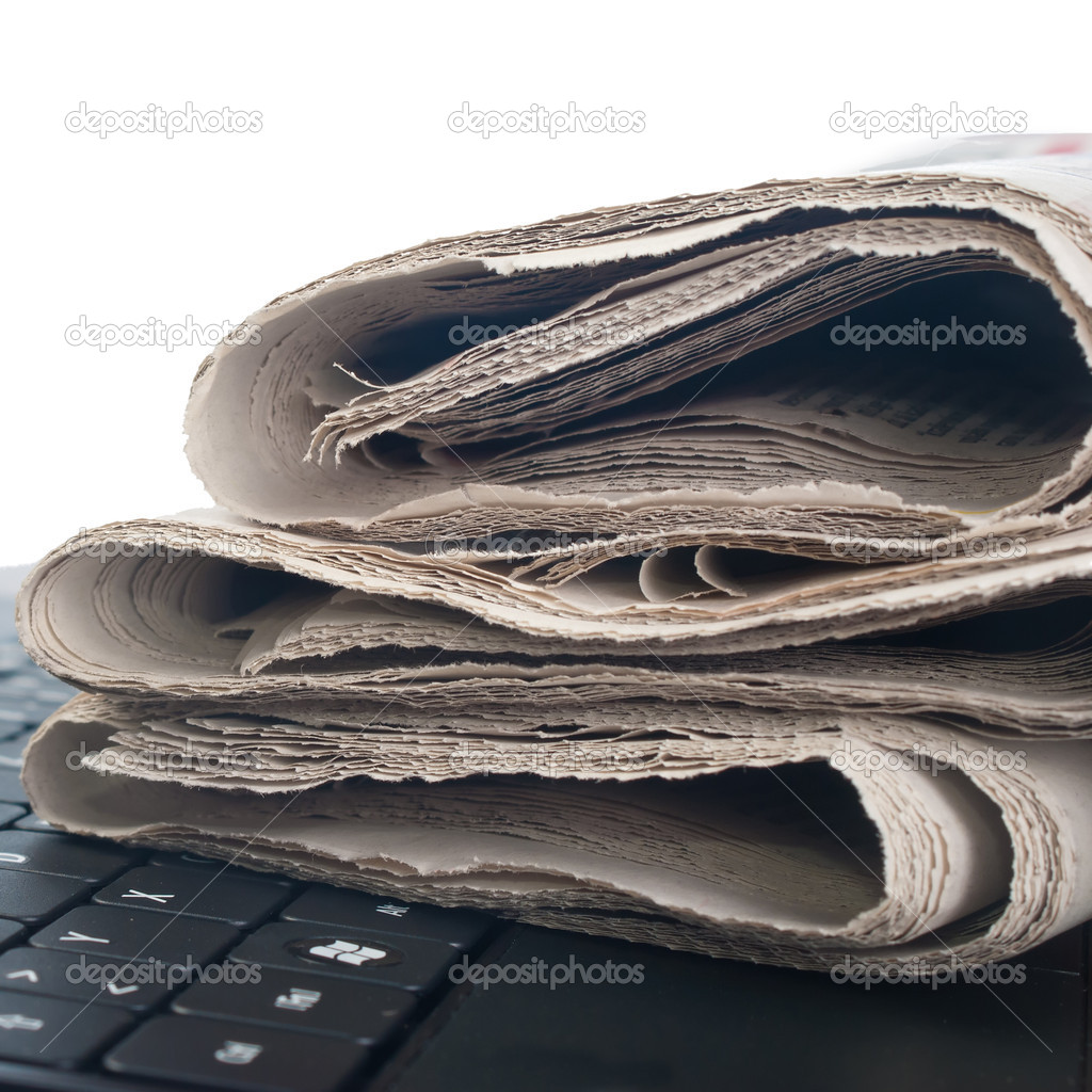 Close up photo of newspaper on the keyboard  Stock Photo #10159280