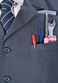 Tools in the businessman pocket — Stock Photo