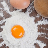 Egg yolk on flour — Stock Photo