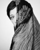 Portrait of a woman with a scarf — Stock Photo