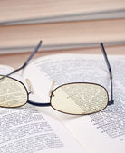 Glasses on the open book — Stock Photo