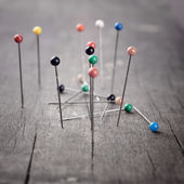 Metal pin in wooden table — Stock Photo