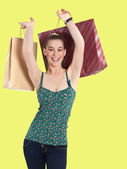 Happy young woman with shopping bags. — Stock Photo