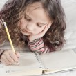 Little girl with notebook and pen — Stock Photo