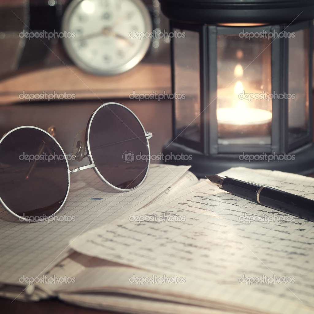 An open old book by the candlelight,close up photo — Stockfoto #9821853