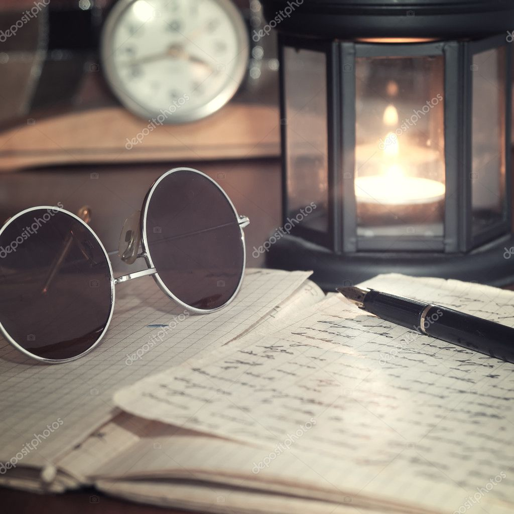 An open old book by the candlelight,close up photo — Stock Photo #9821853