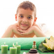 Smiling boy lying on the massage table — Stock Photo