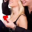 Romantic guy gives girl a red heart — Stock Photo #8830354