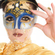 Gold face make-up - Stock Photo