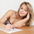 Girl writing a letter — Stock Photo