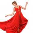Dancing woman in red dress — Stock Photo