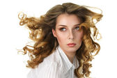 Attractive woman with fly-away long hair — Stock Photo