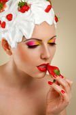 Woman eating strawberry — Stock Photo
