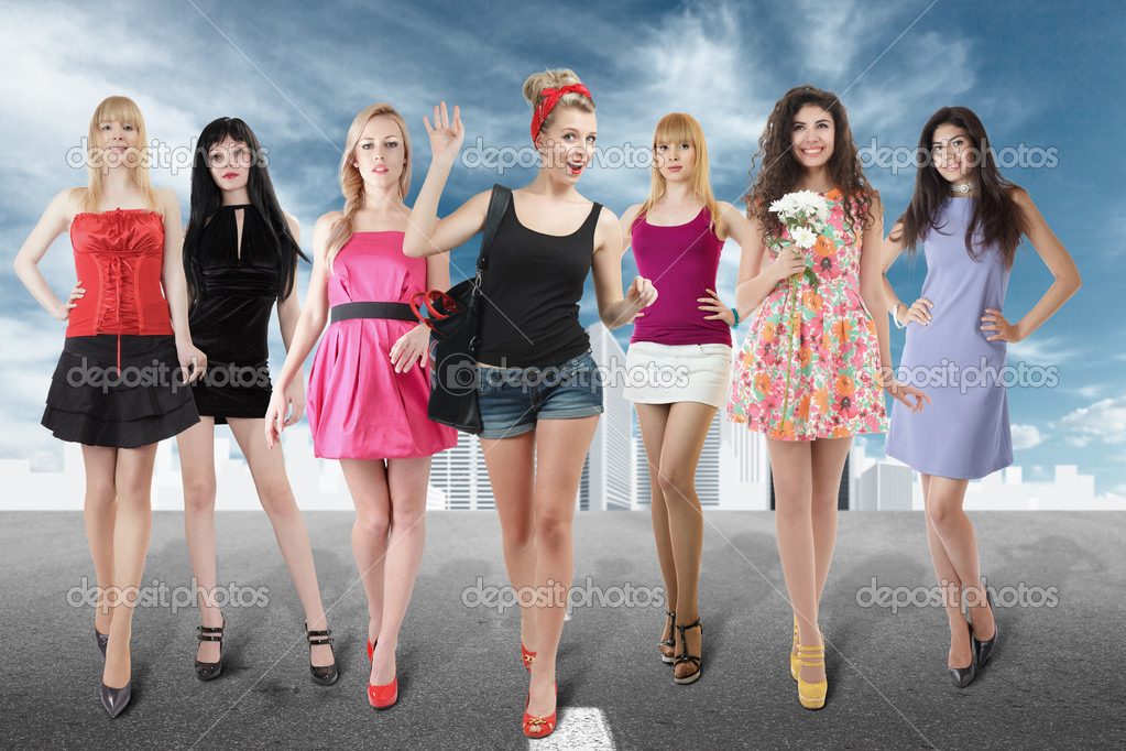 Large group of young women walking on road against abstract cityscape — Stock Photo #9749415