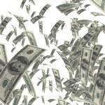peníze padající izolované na bílém — Stock fotografie #10720913