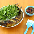 Snake head fish grilled and nim leaf dip with sweet paste on table. — Stock Photo