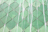 Water fall on green tile wall. — Stock Photo
