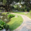 Path walk curve side pond of chinese garden. — Stock Photo