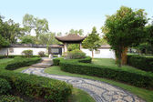 Path walk curve of chinese garden. — Stock Photo
