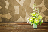 Colorful Artificial Flower Arrangement leaf and wood background — Stock Photo