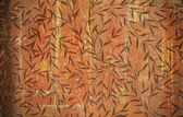 Flower pattern on wood texture — Stock Photo