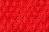 Close up of pattern red wool textile texture — Stock Photo