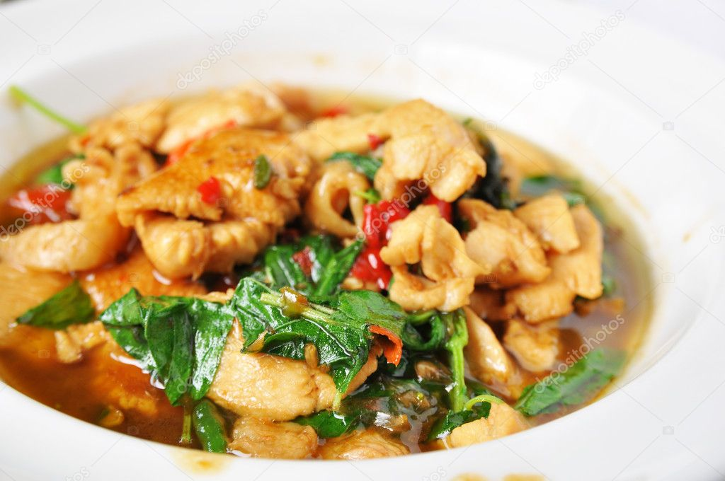 Stir fried chicken with basil (Thai spicy food) — Stock Photo ...